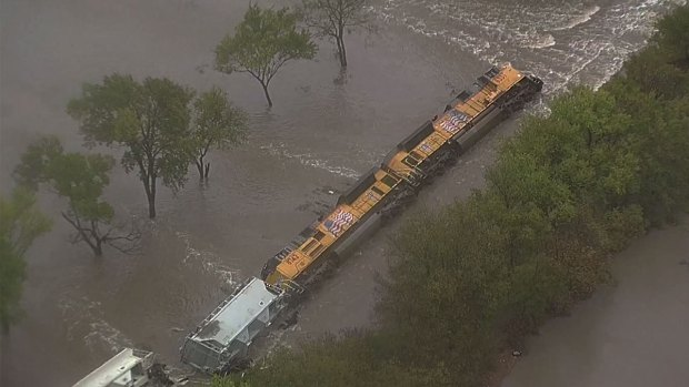 Train Overturns, Partially Submerged by High Water