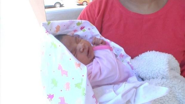 [LA] Mother Holds Newborn as Bus Rolls on Freeway