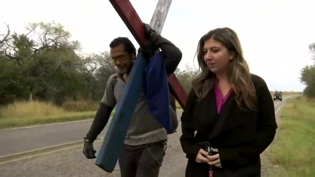 [NATL-DFW] Man Carries Wooden Cross 40 Miles for Church Shooting Victims