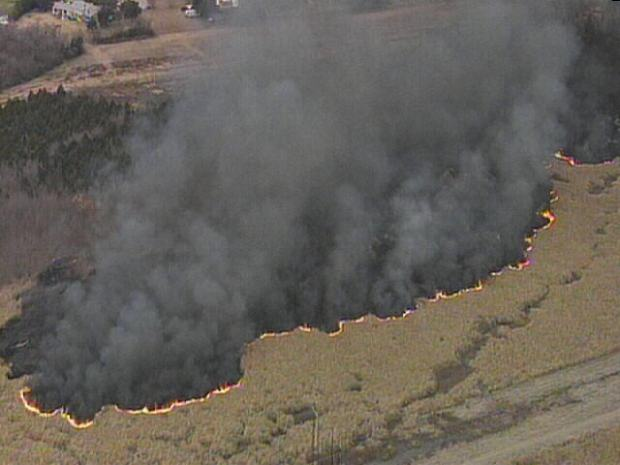 Photos: Onlookers Stop to Watch Grass Fire