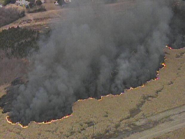 Photos: Onlookers Stop to Watch Grass Fire