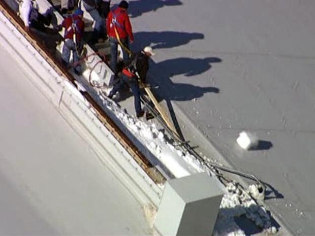 [DFW] Firefighters Chip Away at Ice on Cowboys Stadium Roof