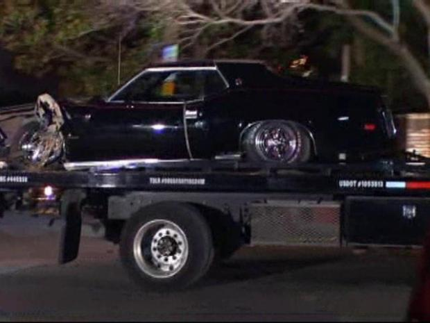 [DFW] RAW VIDEO: Muscle Car Towed From Bush Lawn