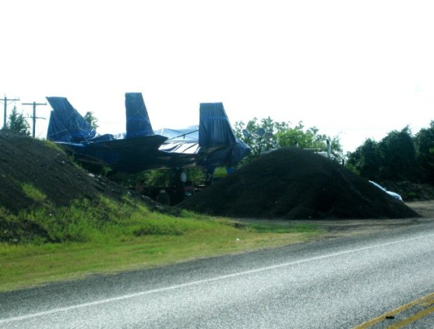 Stealth Fighter Parked on Country Road