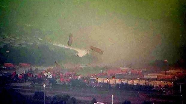 [DFW] Raw Video: Tornado Tosses Trucks