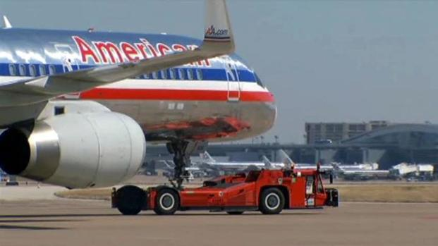 [DFW] AA Saves on Fuel With Tugs, Lighter Drink Carts