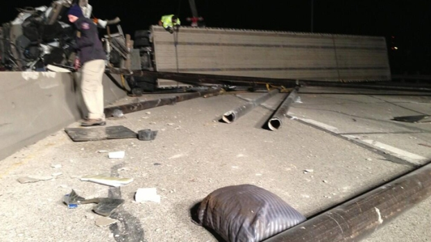 [DFW] Overturned Semi Blocks I-35E With Spilled Pipes