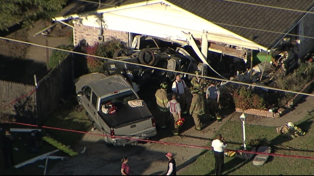 Photos: Car Crashes Into House in Fort Worth