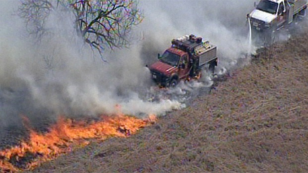 Photos: Grassfire Threatens Homes in Rhome