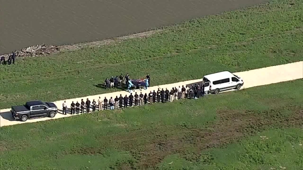 Flag Draped Across Remains Found in Creek