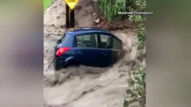 Camera Rolls As Car Gets Swept Away