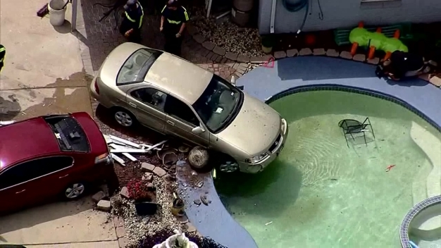 Car Crashes Into Pool at Arlington Home