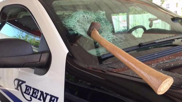 Ax Thrown into Police Car Windshield, Man Arrested<br />