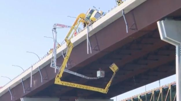Dangling Crane Leaves Workers Hanging