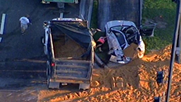 Dump Truck Crash Buries Driver