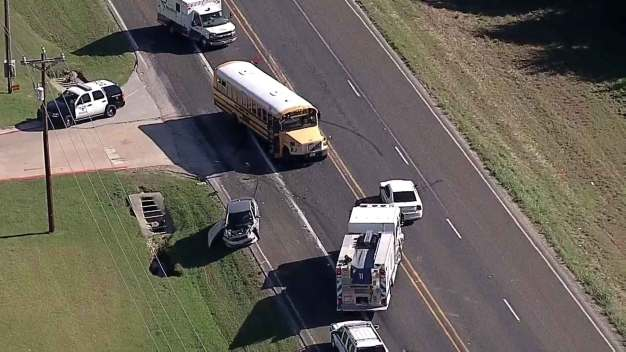 8 Injured When School Bus, Car Collide in Justin