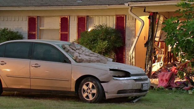 Man Intentionally Slams Car Into Home, Pins Wife Inside