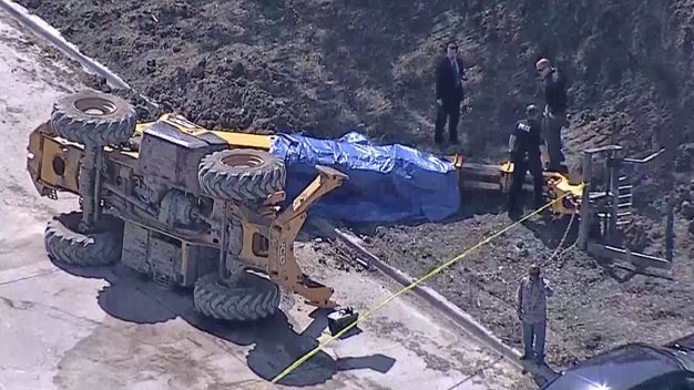Large Forklift Overturns, Killing Driver