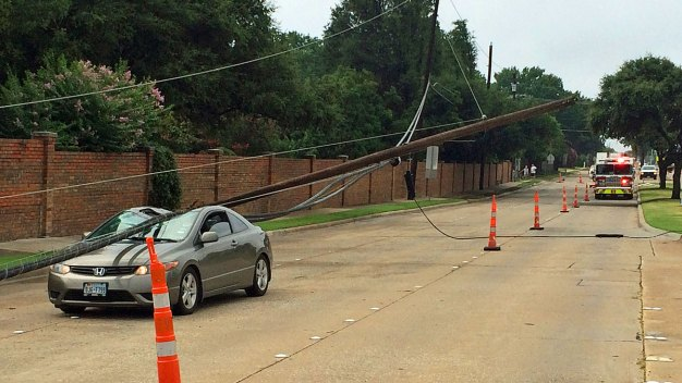 Driver Rescued After Power Pole Crashes Onto Car