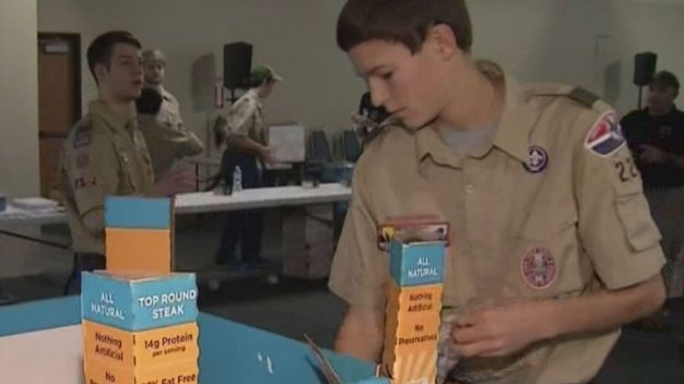 Local Boy Scouts Fill Care Packages for Overseas Soldiers