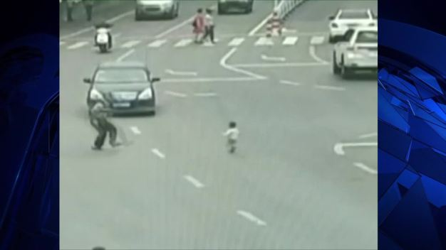 Toddler Rescued From Oncoming Traffic