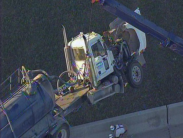 Big-Rig Dangles Off Overpass