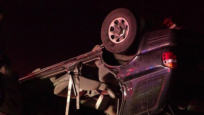 Firefighters Rescue Woman After Rollover Wreck