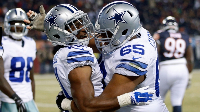 Murray, Romo Lead Cowboys Over Bears 41-28