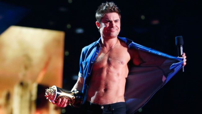 Zac Efron Goes Shirtless, Flaunts Rock-Hard Abs at MTV Movie Awards