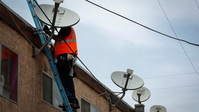 AT&T Says DirecTV Deal Could Slow Price Hikes