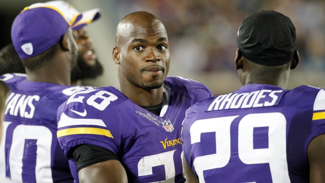 Adrian Peterson Joins Vikings Teammates at OTAs