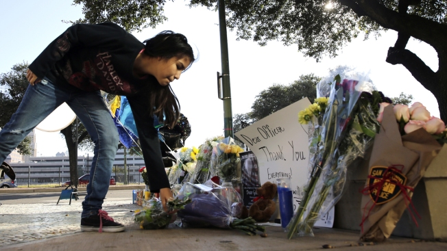 Suspect in Texas officer's death got married after shooting