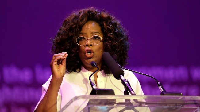 Oprah Offers Rousing Tribute to Mandela in S. Africa Visit