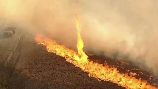 Large grass fire threatens home, forces evacuations in north Texas