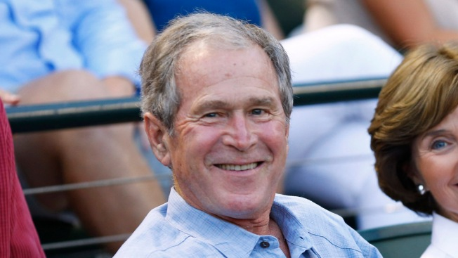 Former President George W. Bush Photobombs TV Reporter During Rangers Game