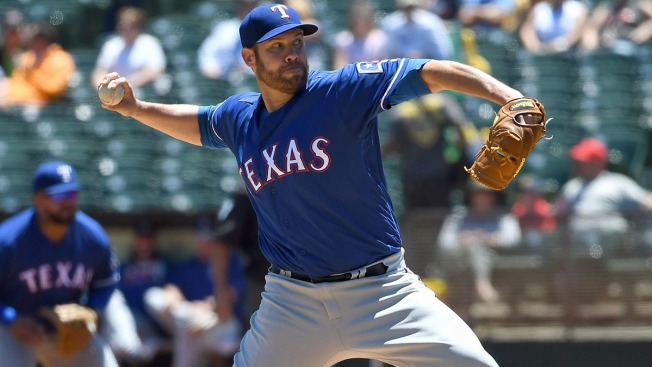 Colby Lewis Pulled From Tuesday's Game Due to Cramping