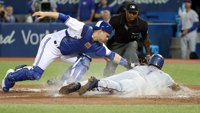 Travis Hits Grand Slam, Blue Jays Beat Rangers 7-6