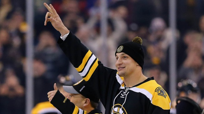 Gronkowski Spikes Puck as Bruins Honor Patriots