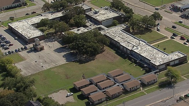 Report of Armed Man Locks Down Dallas Elementary School