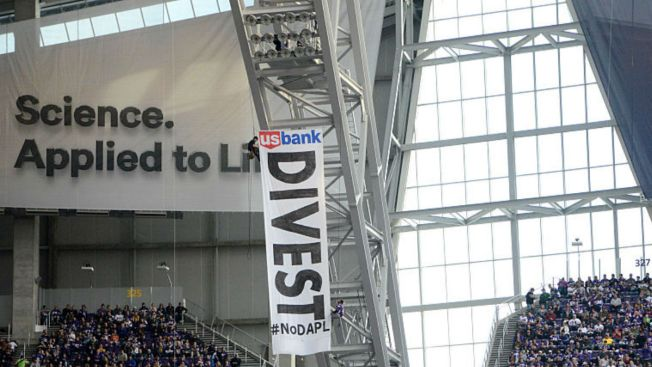 Pipeline Protest Banner Hangs From Rafters at NFL Game