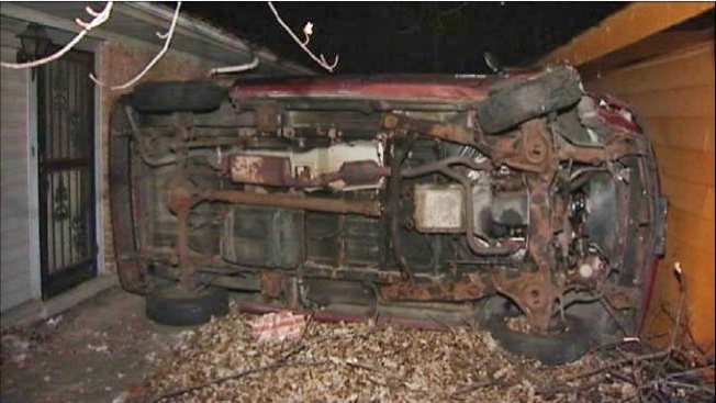 Crashed Car Becomes Wedged Between Two Homes