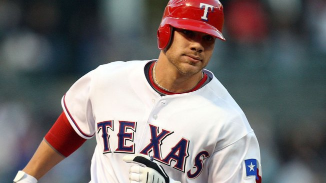Davis' Big Blast Powers Rangers Past Mariners