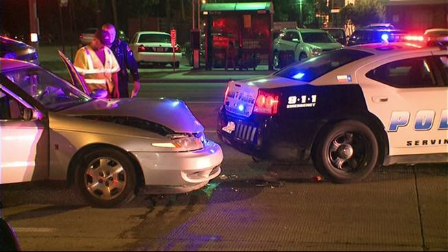Driver Crashes Into Parked Dallas Police Car