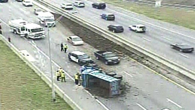 Overturned Dump Truck Spills Debris Across Interstate 30 in West Fort Worth