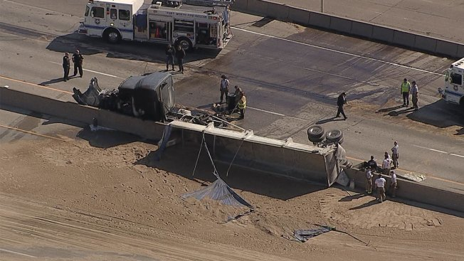 I-35W Closed Due to Overturned Sand Truck
