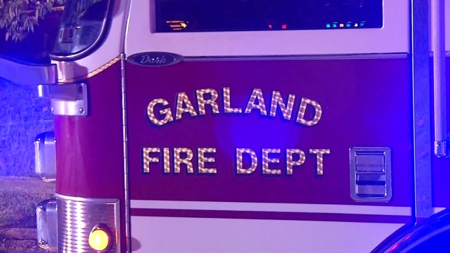 Fire Causes Wall of Garland Home to Collapse
