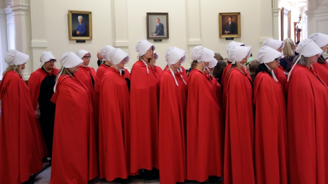 Here's Why Women Keep Dressing Like 'Handmaids' at Statehouses