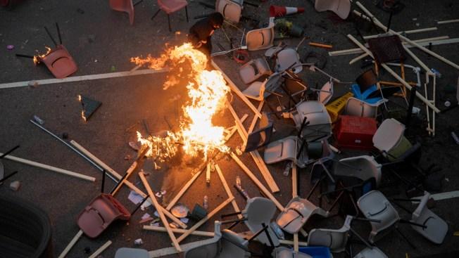 Hong Kong Endures More Transit Disruptions, Campus Violence