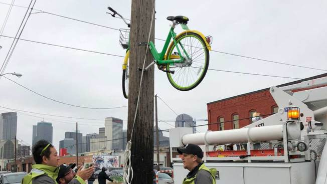 LimeBike Sawed in Half, Bolted to Deep Ellum Telephone Pole