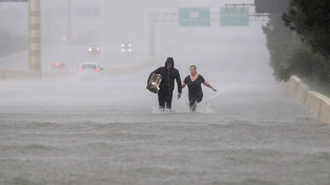 Houston Residents Flee Harvey Floodwaters for Safety at Convention Center